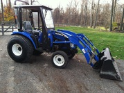 2006 New Holland TC33D 4WD loader snow blower